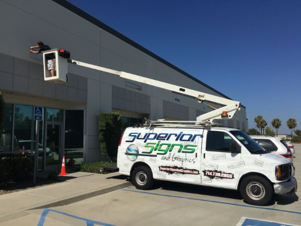 Exterior Sign Installation with Aerial Bucket Van in Buena Park CA