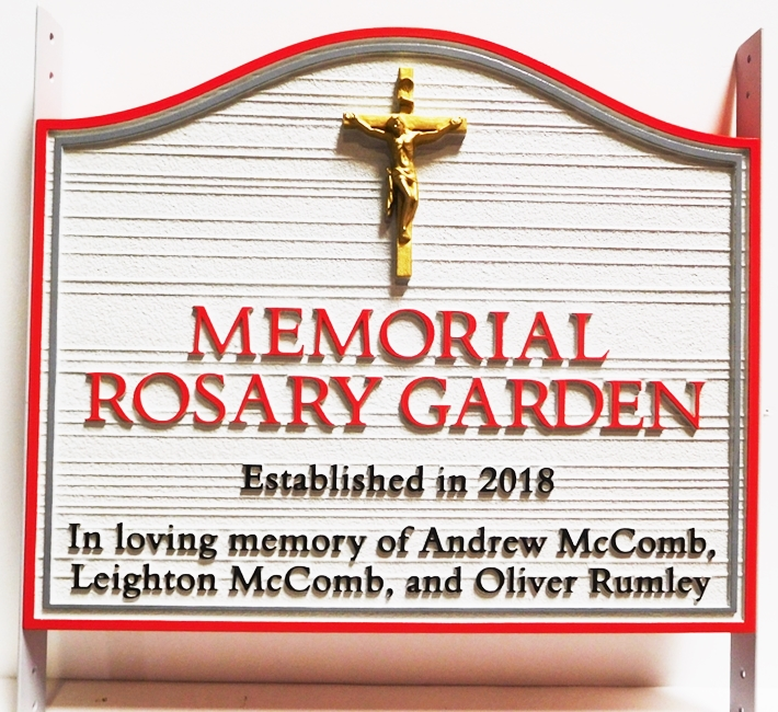 "GA16480 - Carved  and Sandblasted Wood Grain HDU Entrance  Sign  for the Memorial Rosary Garden, with ""Jesus on the Ctoss"" as Carved 3D Artwork."