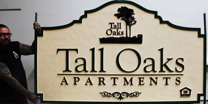 "K20381  - Carved High-Density-Urethane (HDU)  Entrance sign for the ""Tall Oaks Apartments"", 2.5-D, with Oak Trees as Artwork"