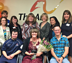 Board members, volunteers and staff celebrate Sara's achievements.