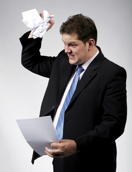 Man Throwing Paper