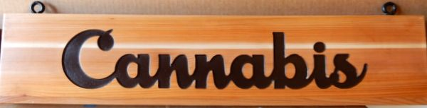 "SA28059 - Stained Wood Plaque with the Text ""Cannabis"""