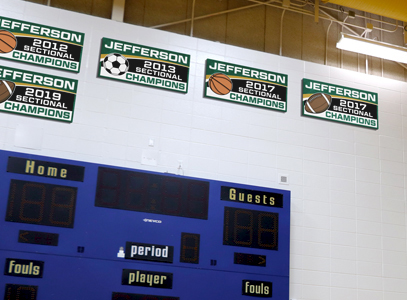 School gym with championship banner boards, school signage company, custom signs