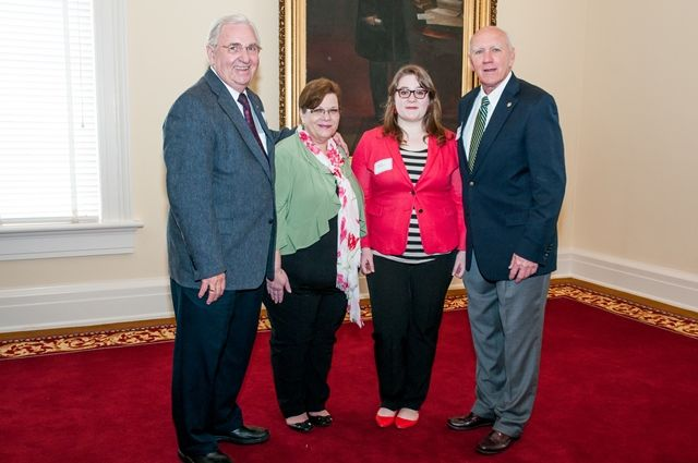 Reps. Joe Faust and Harry Shiver with Baldwin County High School student, mother