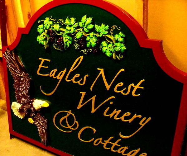 "R27063 - Carved 3-D Sign ""Eagle Nest Winery and Cottages"" with 3-D Bas-Relief Carved Eagle and Grape Vine with Leaves and Grape Clusters"