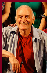 A picture of the founder of TBTB, Ike Schambelan. He is smiling and posing for the photo.