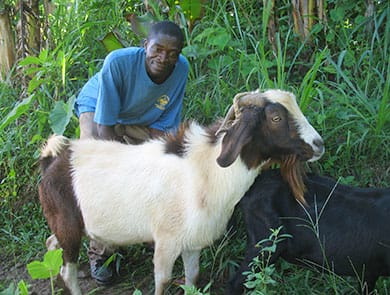 Farmer from the Marinette nursery area poses with his goat.