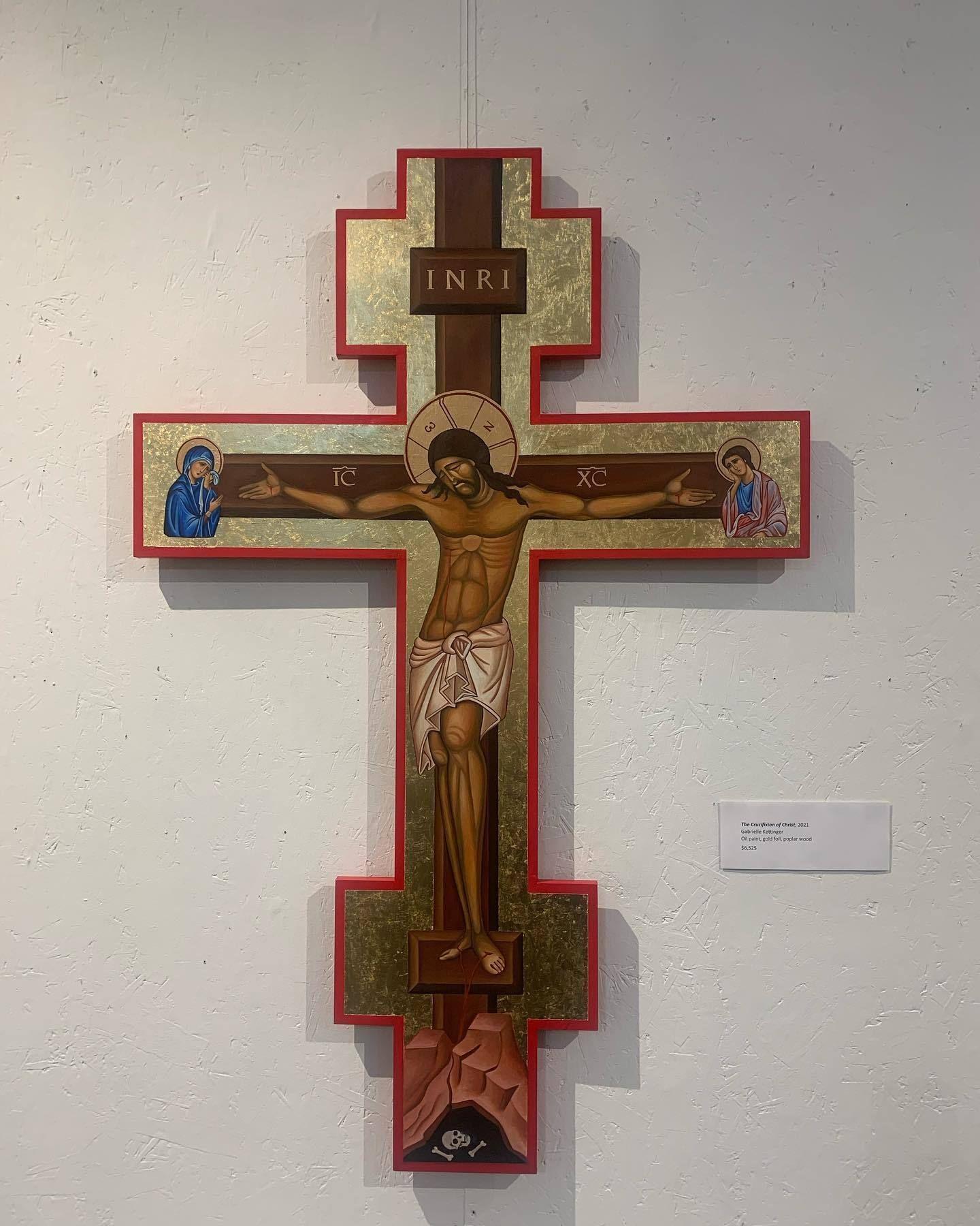 Christ on a golden crucifix by artist Gabrielle Kettinger