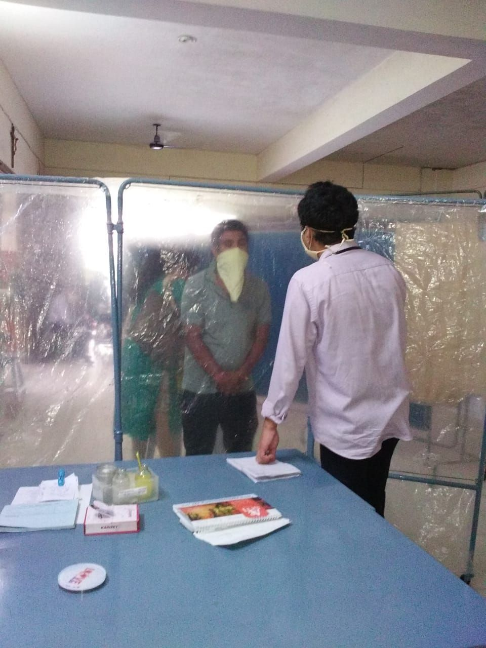 Transparent sheets protect patients and healthcare workers in Kurji Holy Family Hospital.