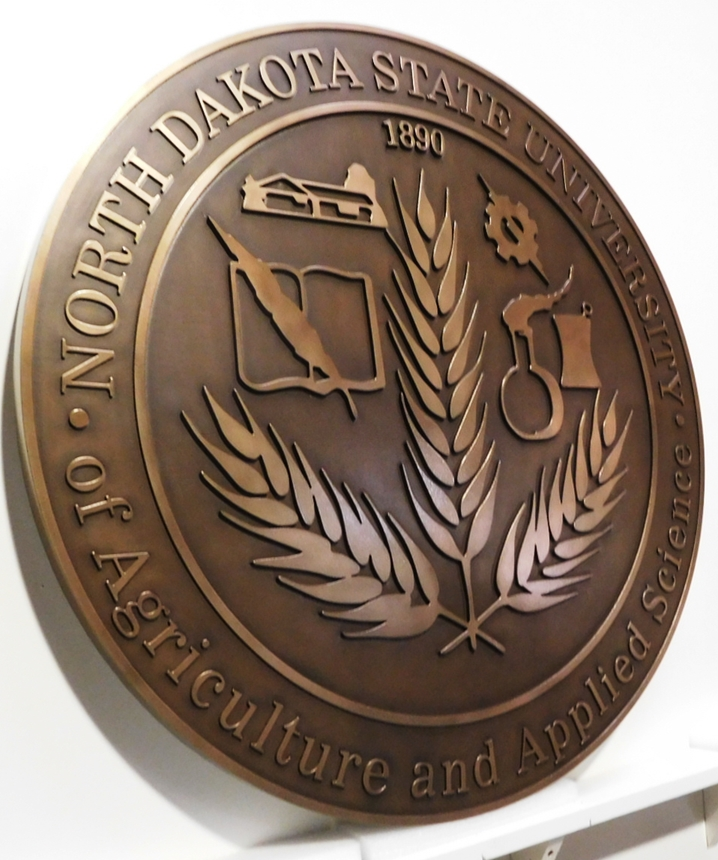 RP-1195 - Carved Plaque of the Seal of the North Dakota State University (side view)