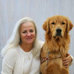 This is a picture of Moira Shea, with her guide dog