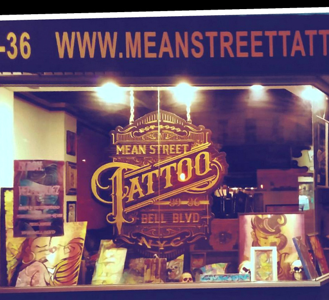 S28078C -  Night Photo of Tattoo Parlor Sign Mounted in Windowfront
