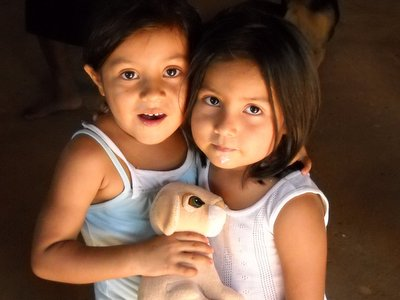 sisters with stuffed animal