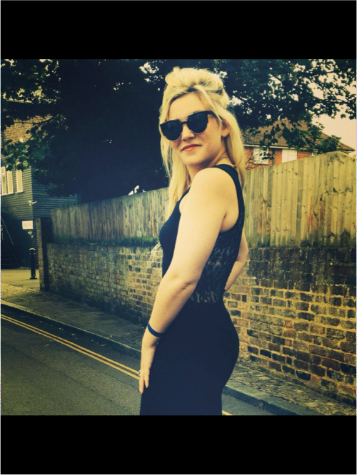 Photo of Molly Watt outside in a black dress and sunglasses