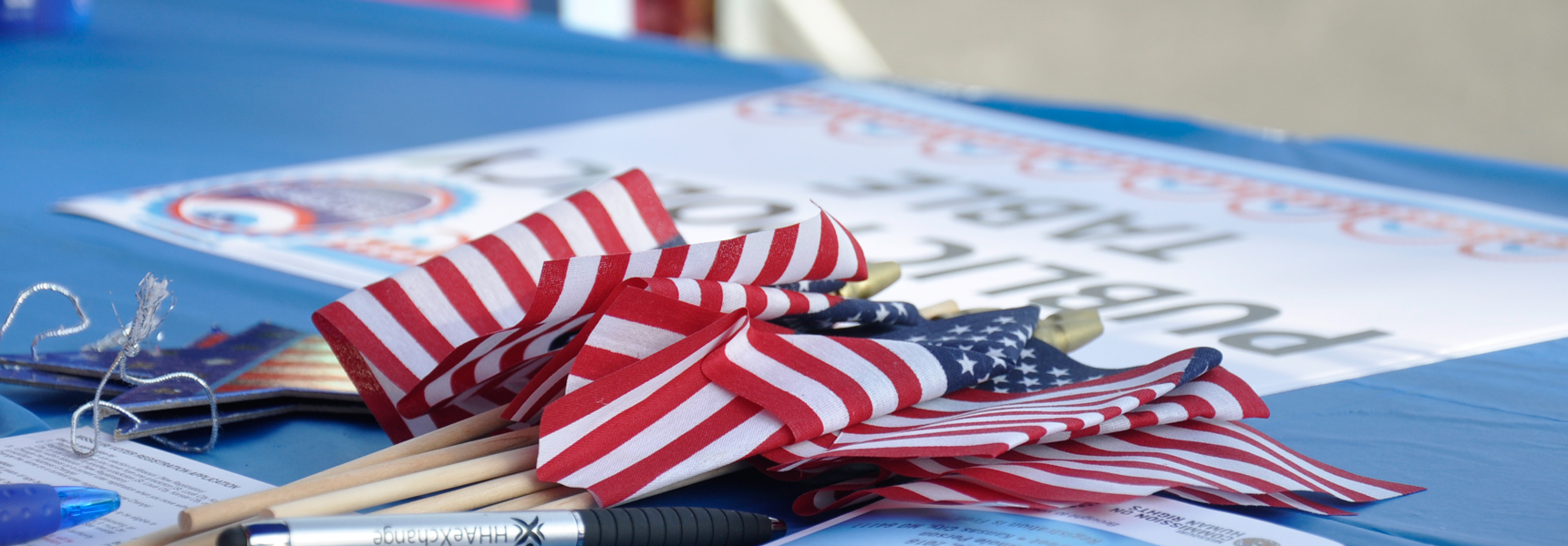 Flags on a table in a voting area