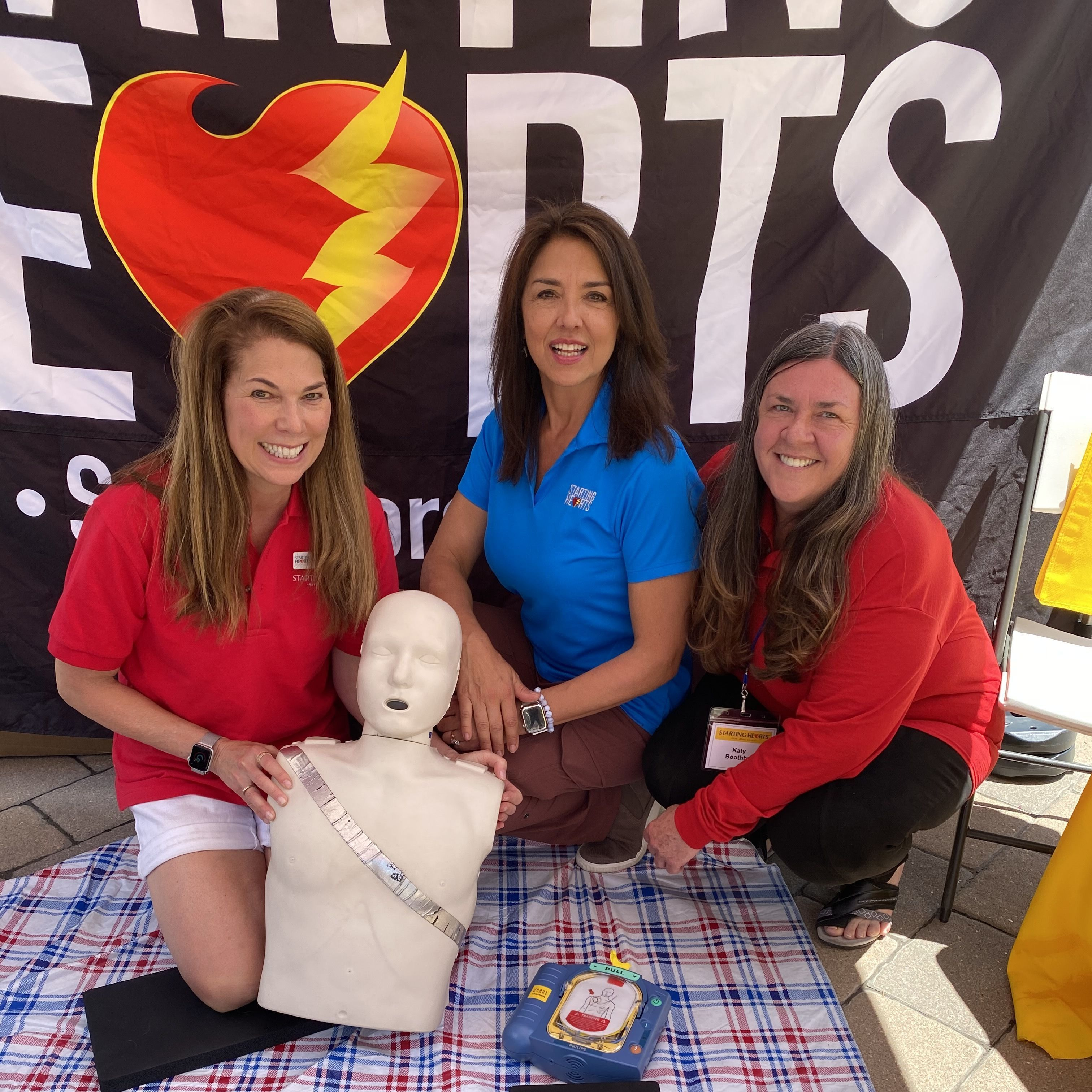 State Representative Dylan Roberts and City Market defib donors, Mikki and Morris Futernick