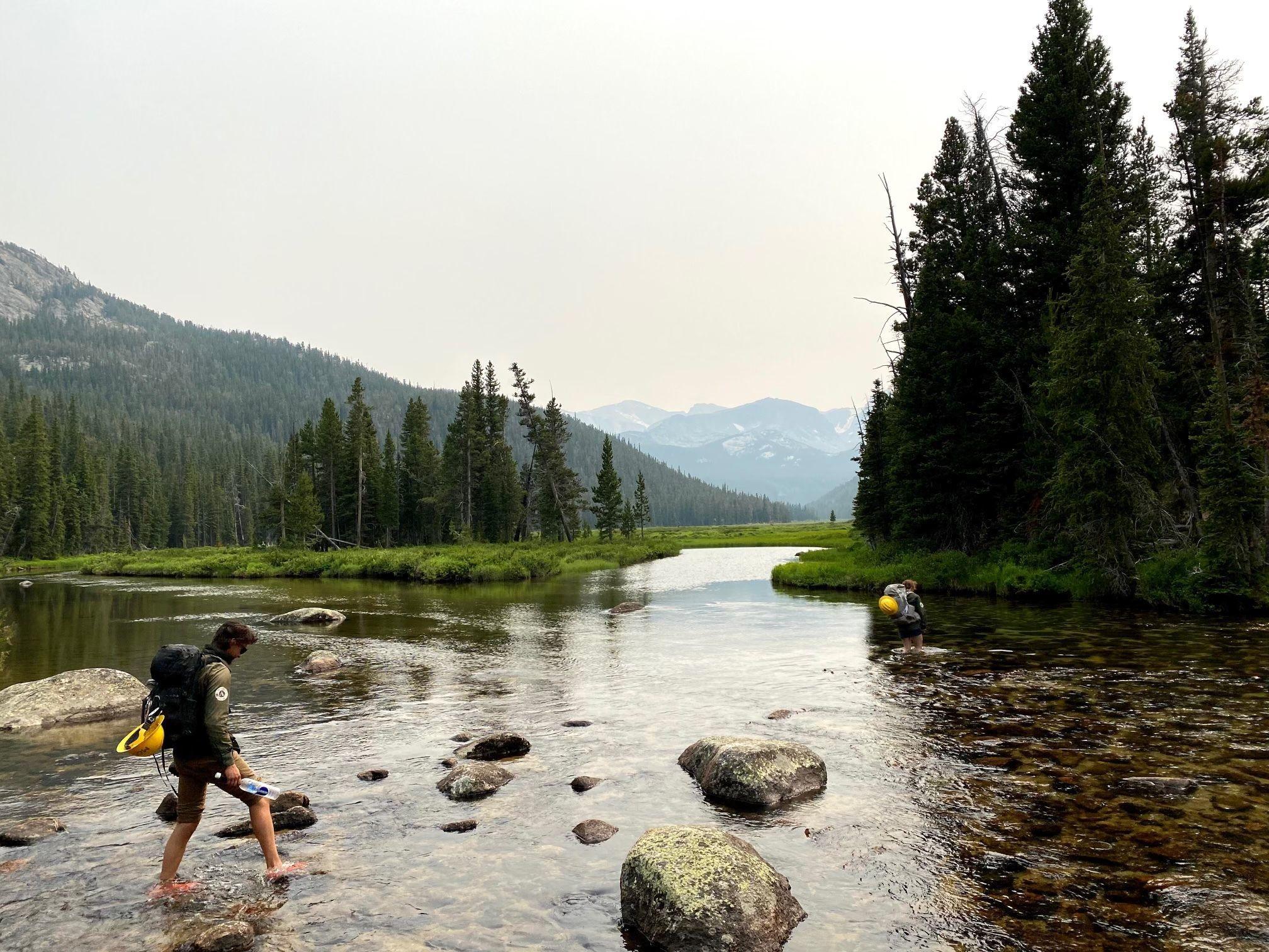 A man crosses a river