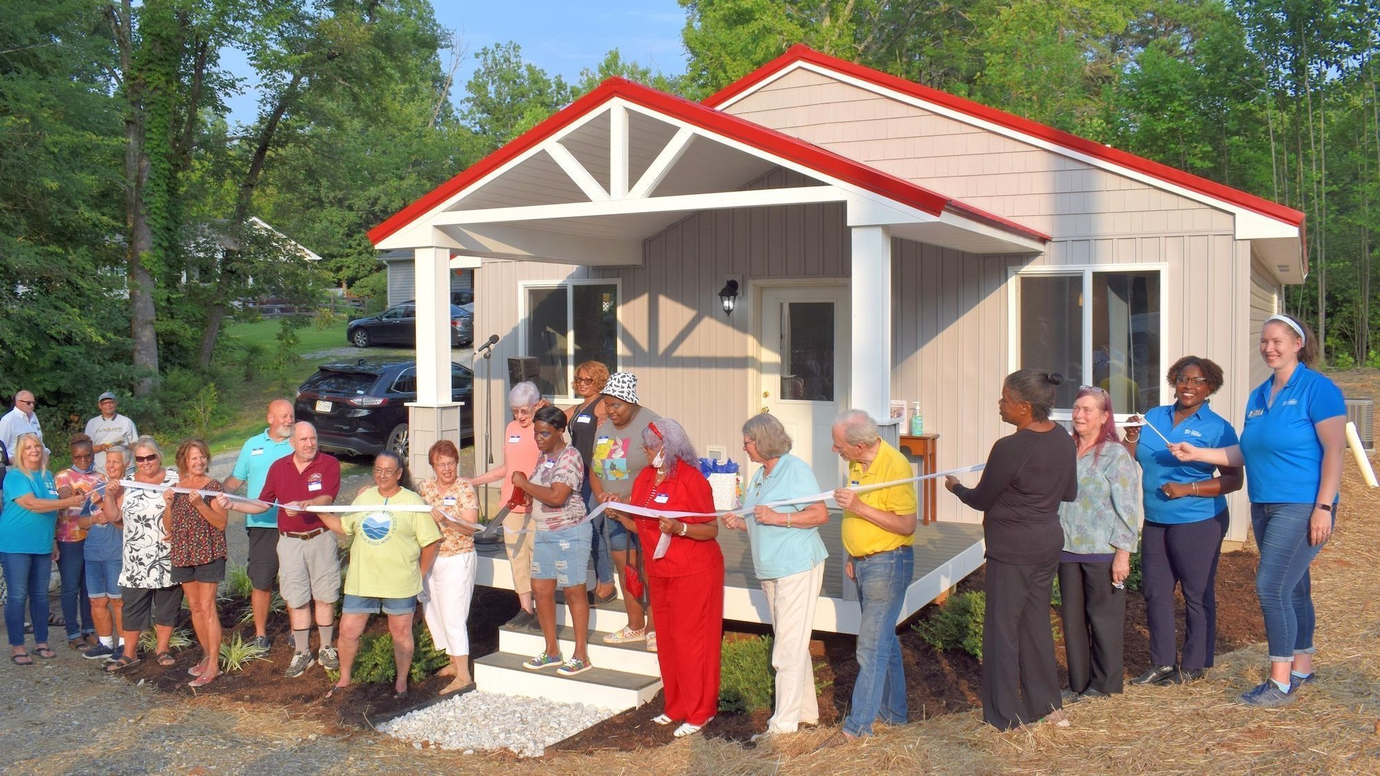 Habitat homeowner cuts ribbon on new home with her three children