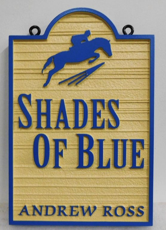 """P25074 - Carved and Sandblasted Wood Grain Entrance Sign for the """"Shades of Blue"""" Facility with a Silhouette of an Horse and Rider Jumping over a Fence as Artwork"""