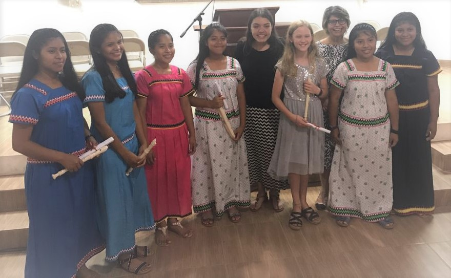 Girls with instruments after music camp