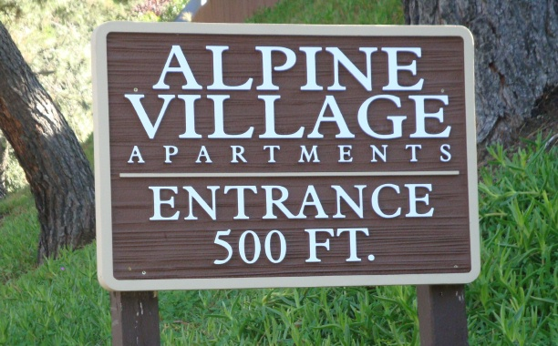 "KA20605 - Carved Wood Look HDU Sign for Apartment Entrance, ""Alpine Village Apartments Entrance 500 Feet"""