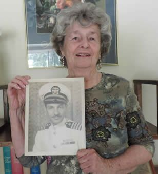 Patricia Holtwick Moran with photo of her father, Navy Captain Jack Holtwick