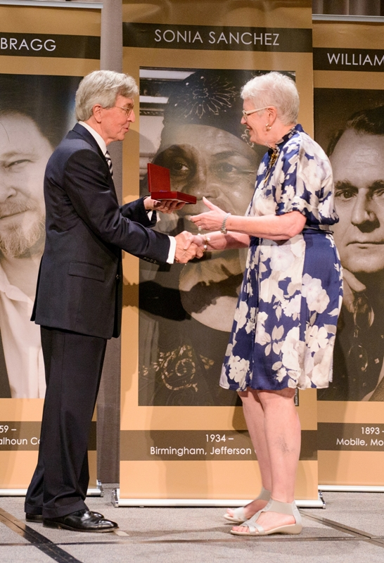 Dean Louis Pitschmann presents Mary Lou Meaher with the Augusta Jane Evans Wilson medal.