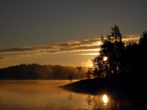 Sunset over lake and mountains in Savonlinna, Finland