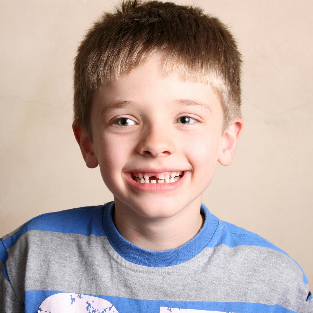 Boy smiling, not making eye contact