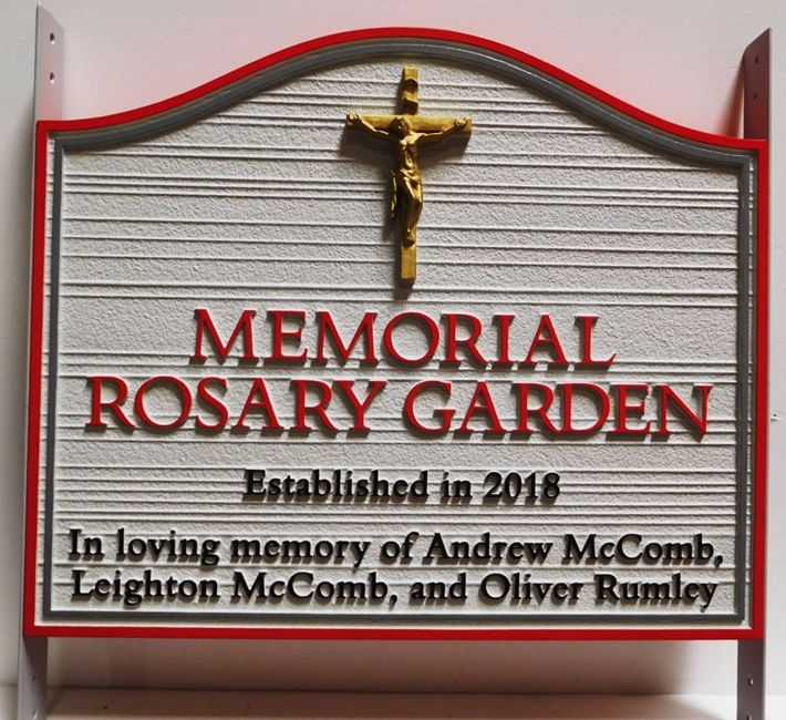 "GA16484 - Carved  and Sandblasted Wood Grain HDU Entrance  Sign  for the Memorial Rosary Garden, with ""Jesus on the Ctoss"" as Carved 3D Artwork."