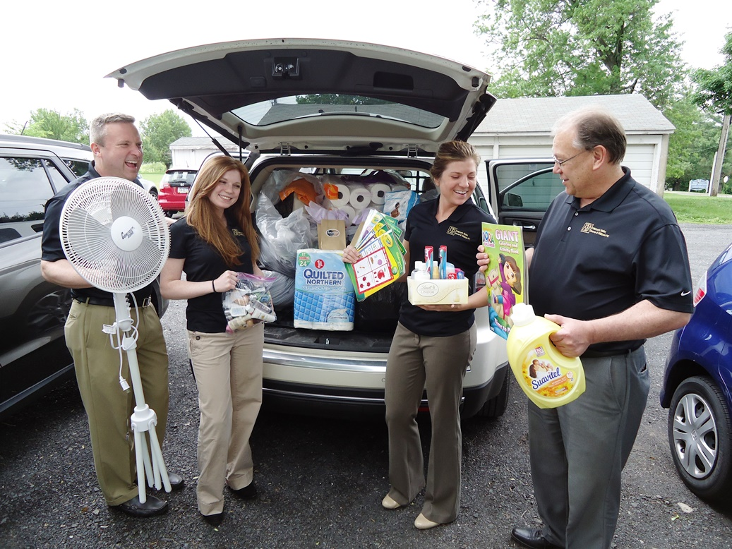 A local business with their community collection for AWP's shelter residents.