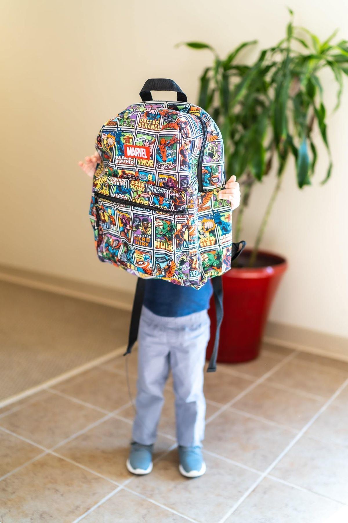 Kid with backpack.