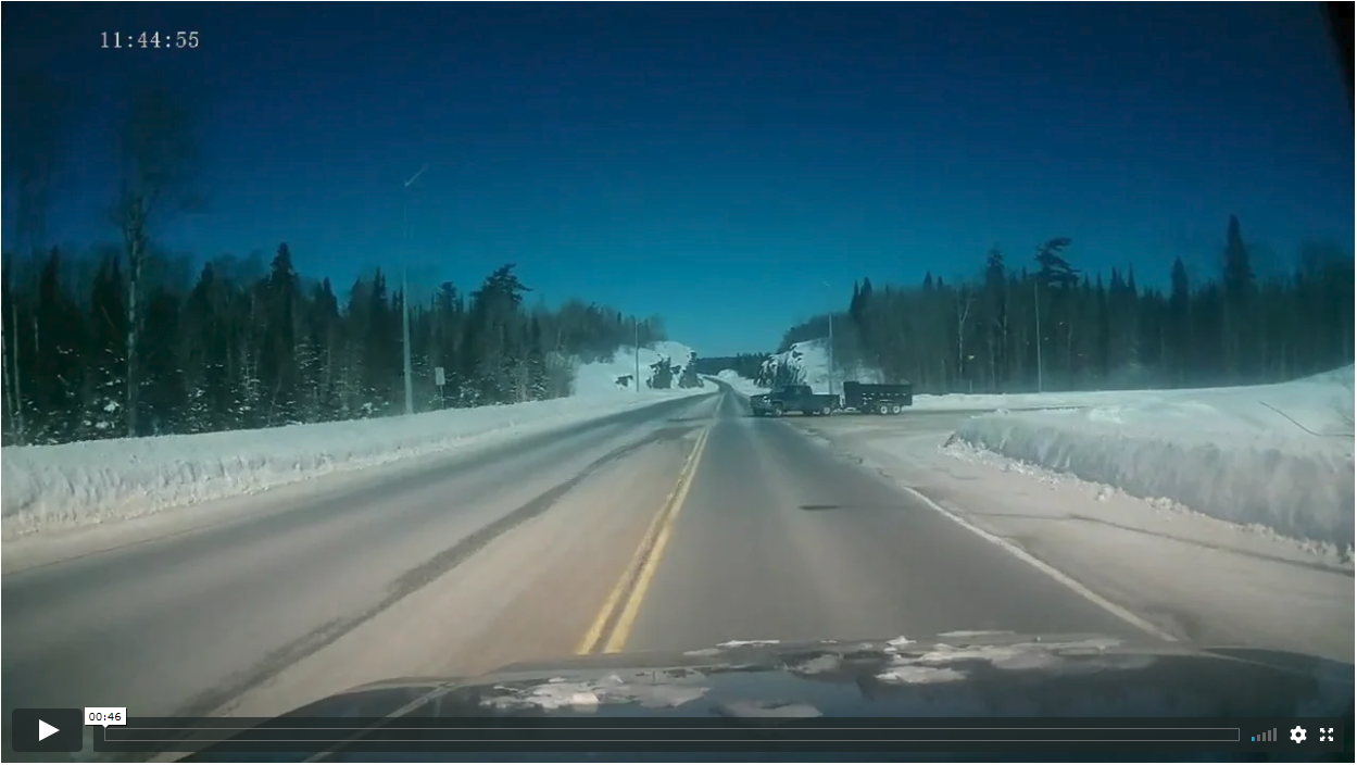 Distracted Driver Pulls In Front of Truck On Icy Road
