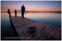 This is a picture of the sunset off a dock