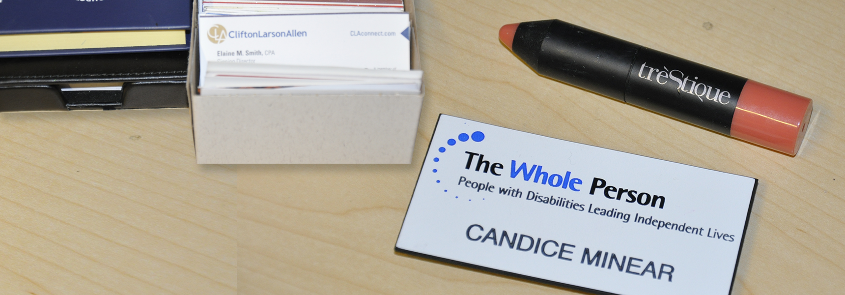 Business cards, lipstick and name badge for Candice Minear
