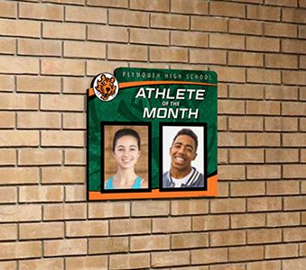 School hallway with athlete of the month picture display, custom signs, school signage company