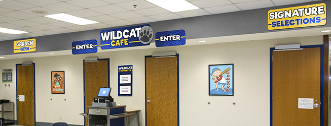 Custom school signs in a cafeteria entrance, school spirit signs with custom logo, menu board