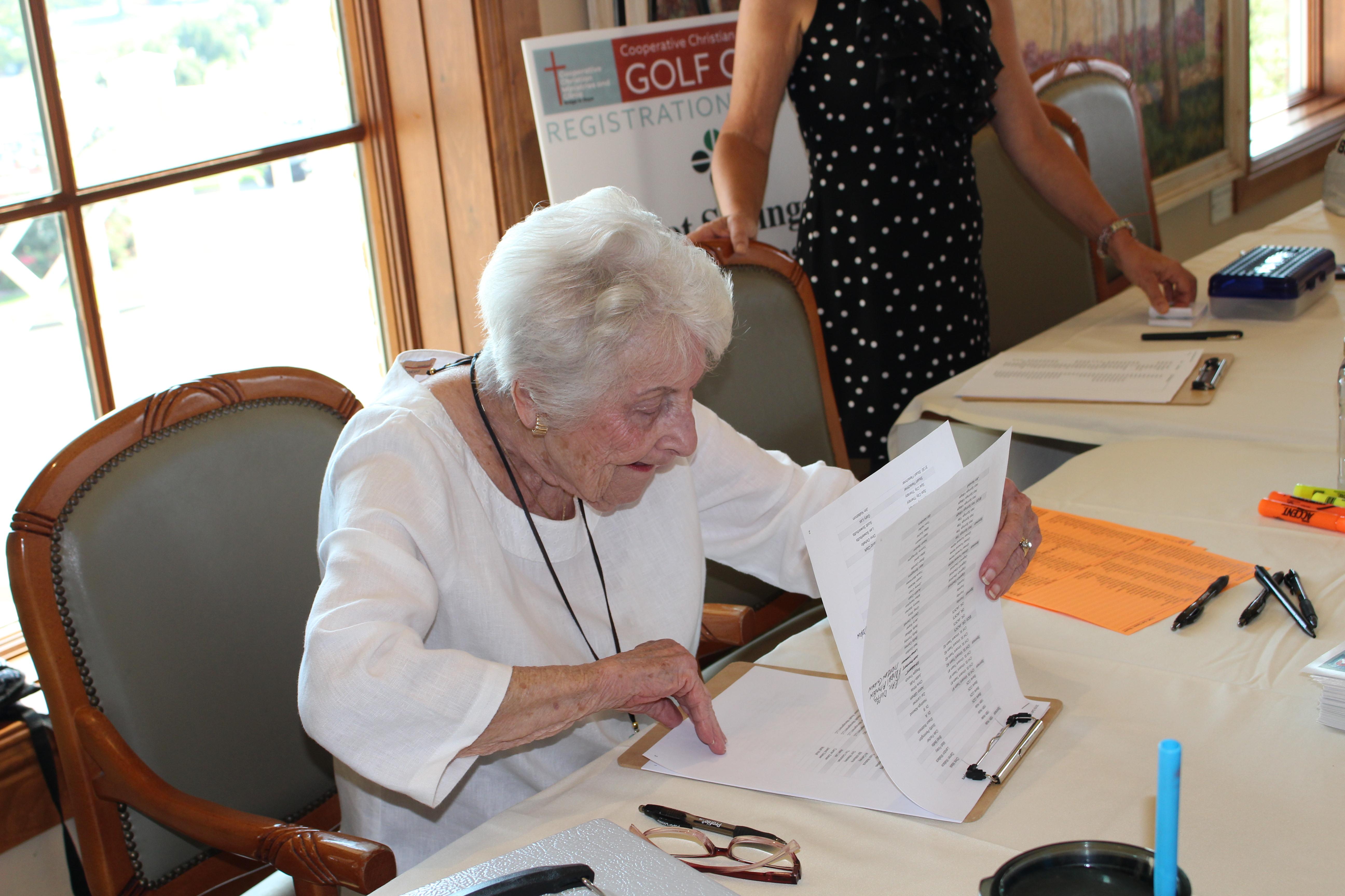 Volunteer Ann Felsted Checks In Golfers