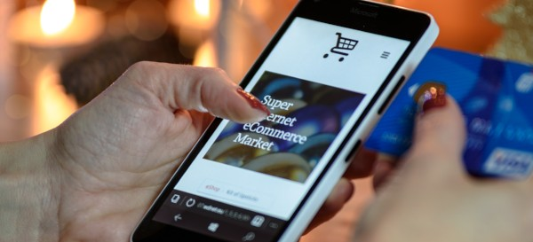 E-commerce market home page on iPhone screen
