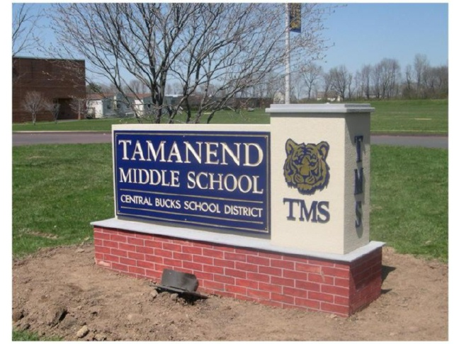 FA15700 -Entrance Monument Sign for Tamenend Middle School, with Tiger Logo on Monument Bases