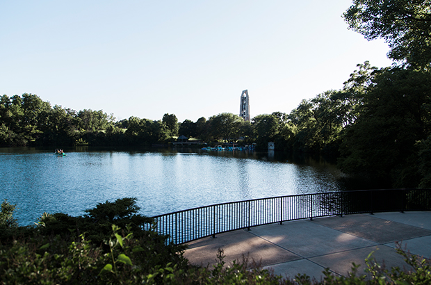 An image of Downtown Naperville's River Walk showing the Millennium Carillon in the background