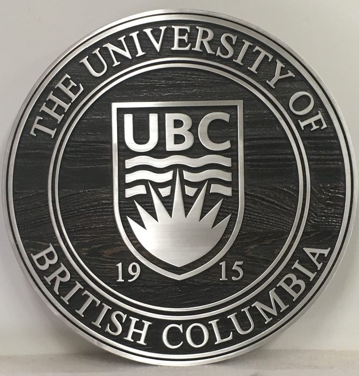 FA15581- Wall Plaque of the Seal of  the  University of British Columbia, 2.5-D  Stained Cedar with Polished Aluminum Overlay