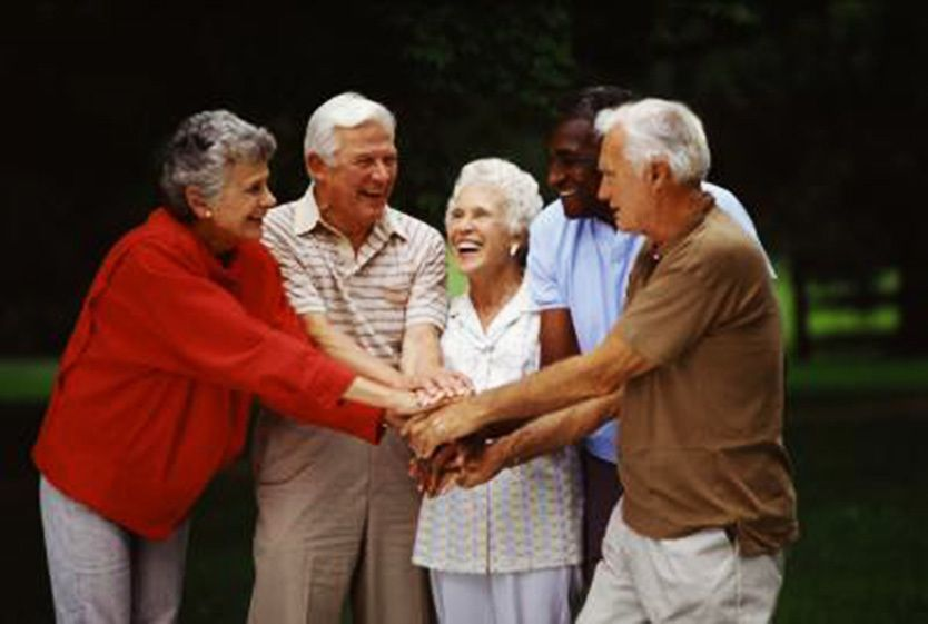 Group of elderly people smiling.