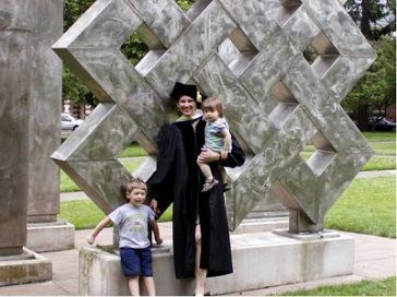 A picture of the blogger with her two kids after her graduation