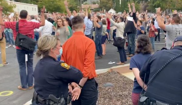 Christians arrested for singing maskless outside city hall