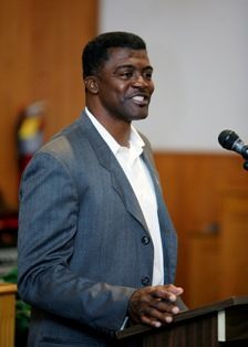 """Frederick """"Freddie"""" Robinson addresses a standing-room-only audience."""