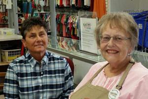 Two volunteers at Village General Store