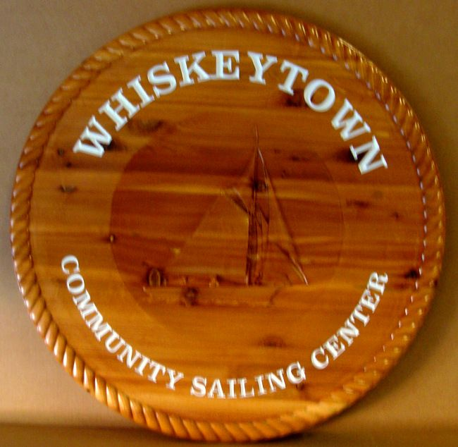 "L21316 -  Carved 3-D Round Wall Plaque for Whiskeytown Community Sailing Center"",with  a Cutter Sailboat"