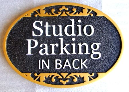 "SA28750 - Decoratively Carved 2.5-D  ""Studio Parking in Back"" Sign"