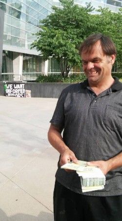 Eric Brandt shares FIJA Fresh Air for Justice brochures outside the Lindsey-Flanigan Courthouse